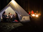 three-female-cubs-in-tent-with-campfire-jpg